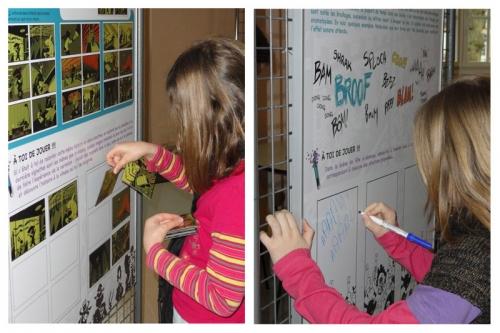 Le laboratoire de bande dessinée, deux jeunes jouent dans l'exposition